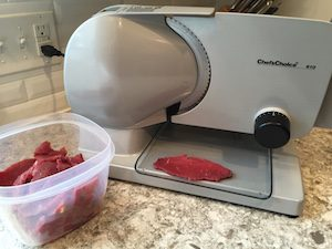 Use a food slicer to cut strips from a semi-frozen roast for even thickness. Even thickness=even cook time.